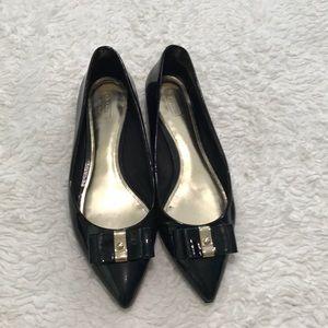 Women's Coach black patent leather flats